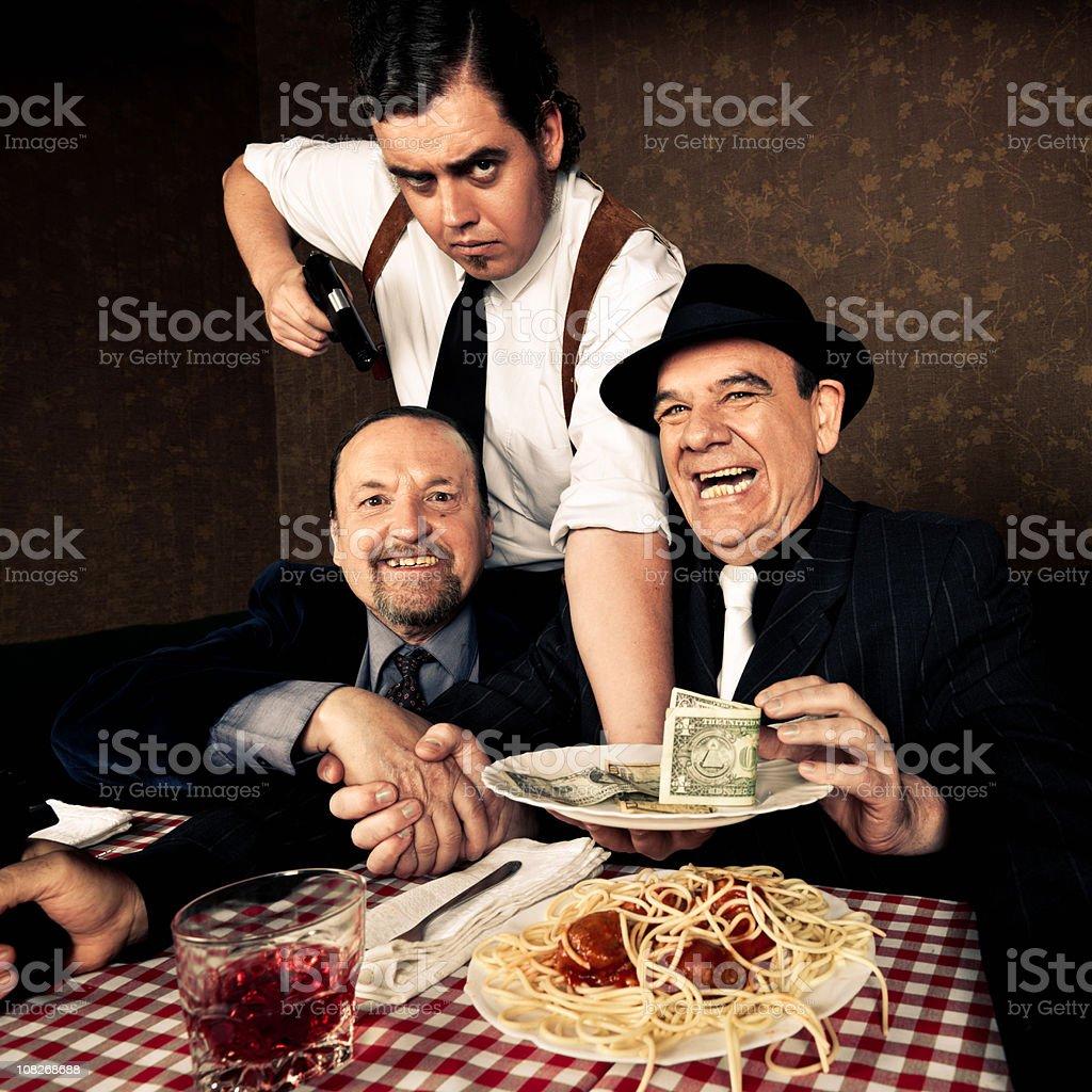 Mafia Men Scene in Italian Restaurant royalty-free stock photo