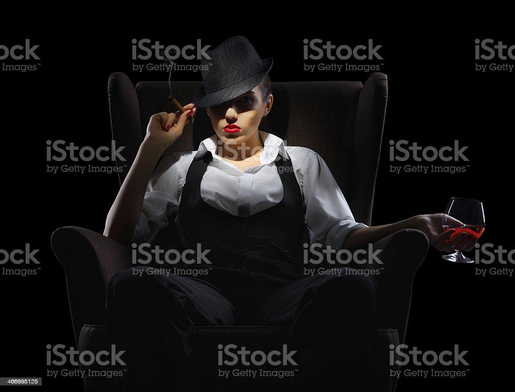 Mafiosi woman with cigar and cognac glass stock photo