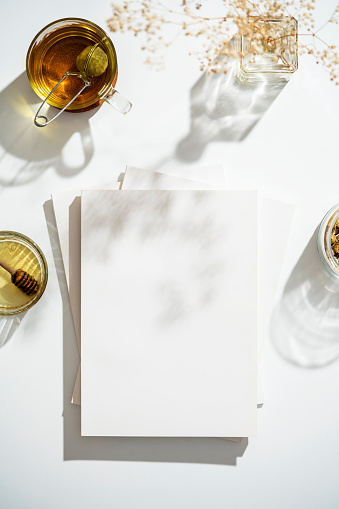Magazine cover mockup, template on table with cup of herbal tea