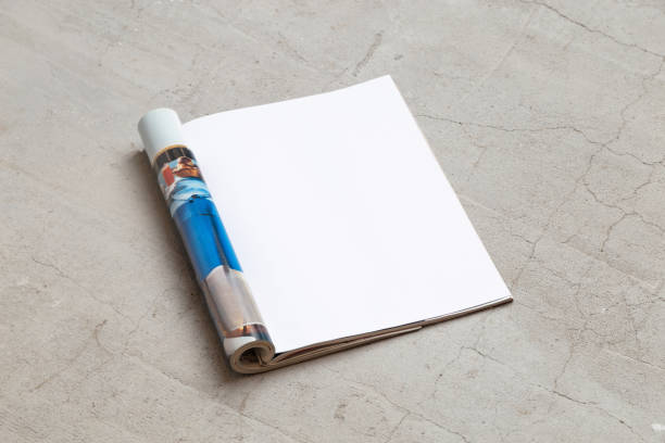 magazine mockup template. open page of the magazine, lies on a concrete floor. top view. copy space - magazine mockup stock photos and pictures