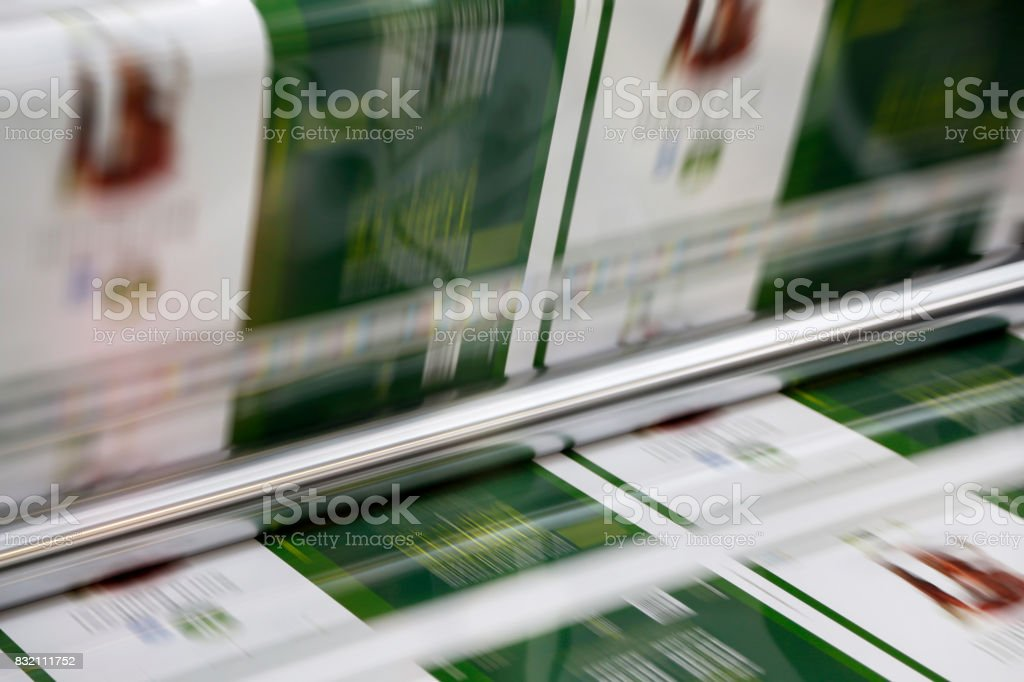 Magazine offset printing machine close up stock photo