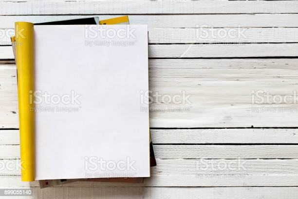 Magazine page mock up catalog opened on a white wooden background. Top view. Copy space