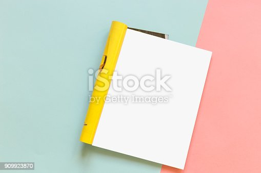 932100364 istock photo Magazine page on a pink and blue background. Fashion magazine. Mock up 909923870