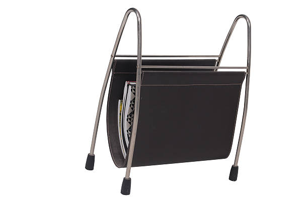 Magazine rack A metal and canvas magazine rack on a white background magazine rack stock pictures, royalty-free photos & images
