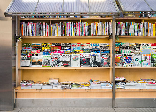 Magazine stand selection A large selection of magazine titles on display outside a kiosk in Tokyo, Japan. magazine rack stock pictures, royalty-free photos & images