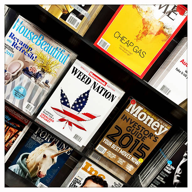Magazines at News Stand Pittsburgh, USA - January 28, 2015 -  Popular magazines at a news stand.   Photographed with an iPhone. time magazine stock pictures, royalty-free photos & images