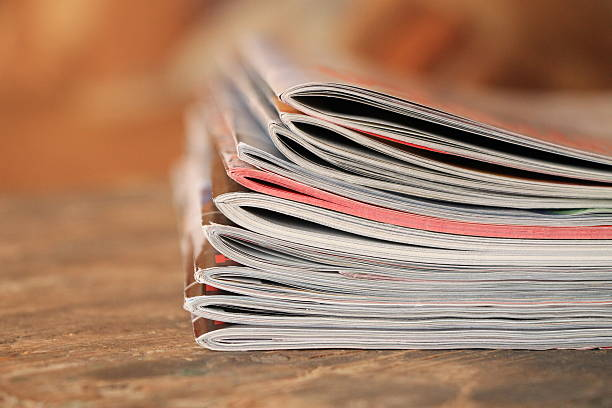 magazines on the wooden table - publication stock pictures, royalty-free photos & images