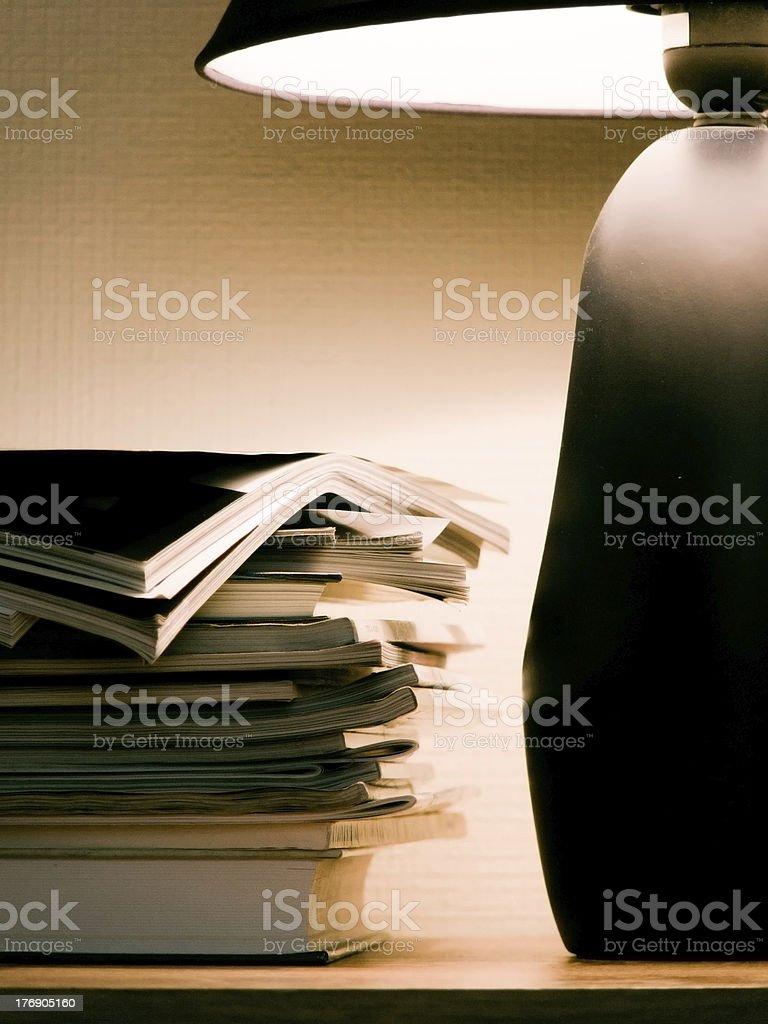 Magazines under evening lamp light royalty-free stock photo