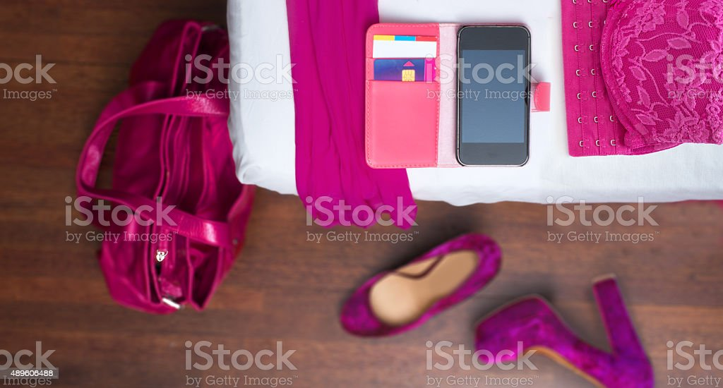 Magenta day pink outfit on the hotel bed stock photo