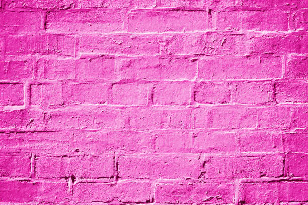 magenta fuchsia hot pink brick wall background texture - magenta stock photos and pictures