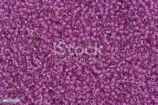 istock Magenta glass beads. Hi res photo 889755094