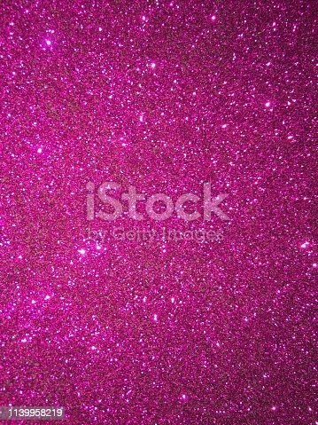 istock Magenta glitter texture and sparkle abstract background 1139958219