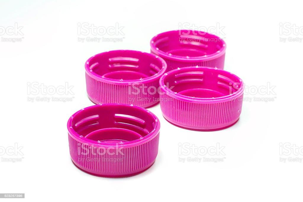 Magenta plastic bottle caps stock photo