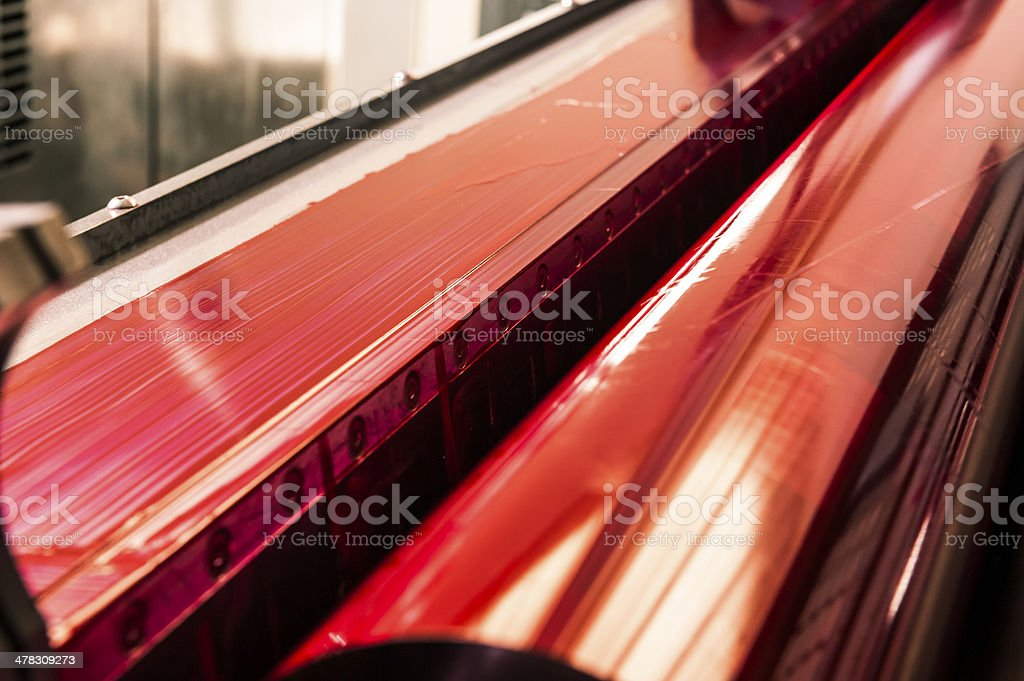 Magenta Printing Roller of a CMYK Industrial Lithograph Printer stock photo