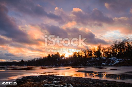 Magnificent sunset reflects over frozen lake at High Point State Park, top of New Jersey