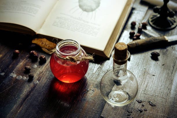 Magic and wizardry concept. Magic and wizardry concept. Set of sorcery book, magic potion on table. Health potion. Alchemy concept. arcane stock pictures, royalty-free photos & images