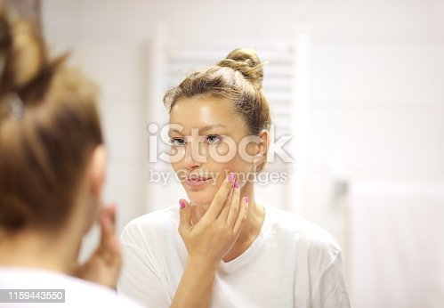 istock Magic anti-aging cream.Applying the cream 1159443550