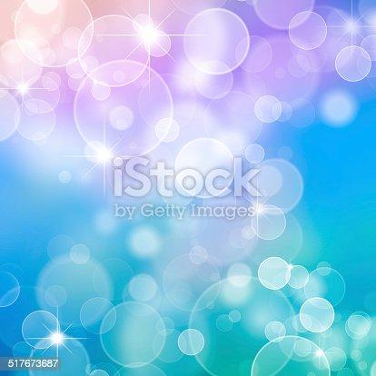 621592540istockphoto Magic blue bubbles and glitters 517673687