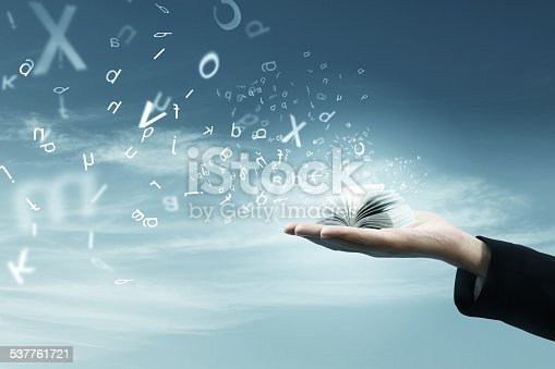 istock Magic book on hand 537761721