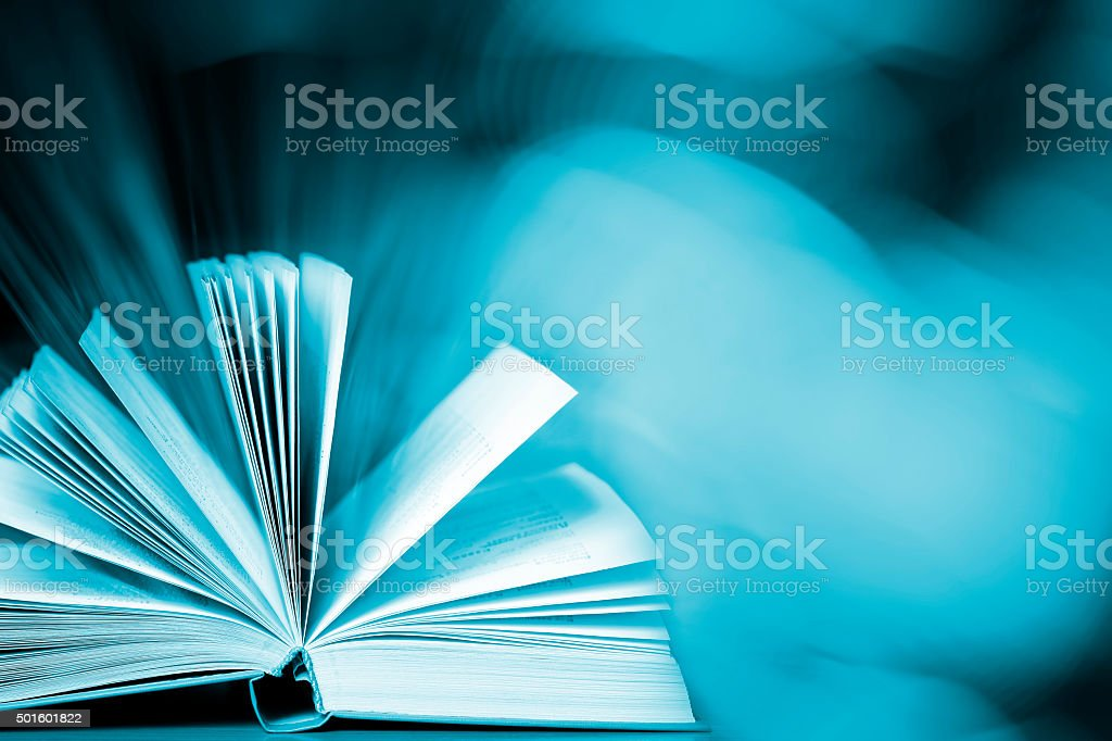 Magic book (with copyspace) stock photo