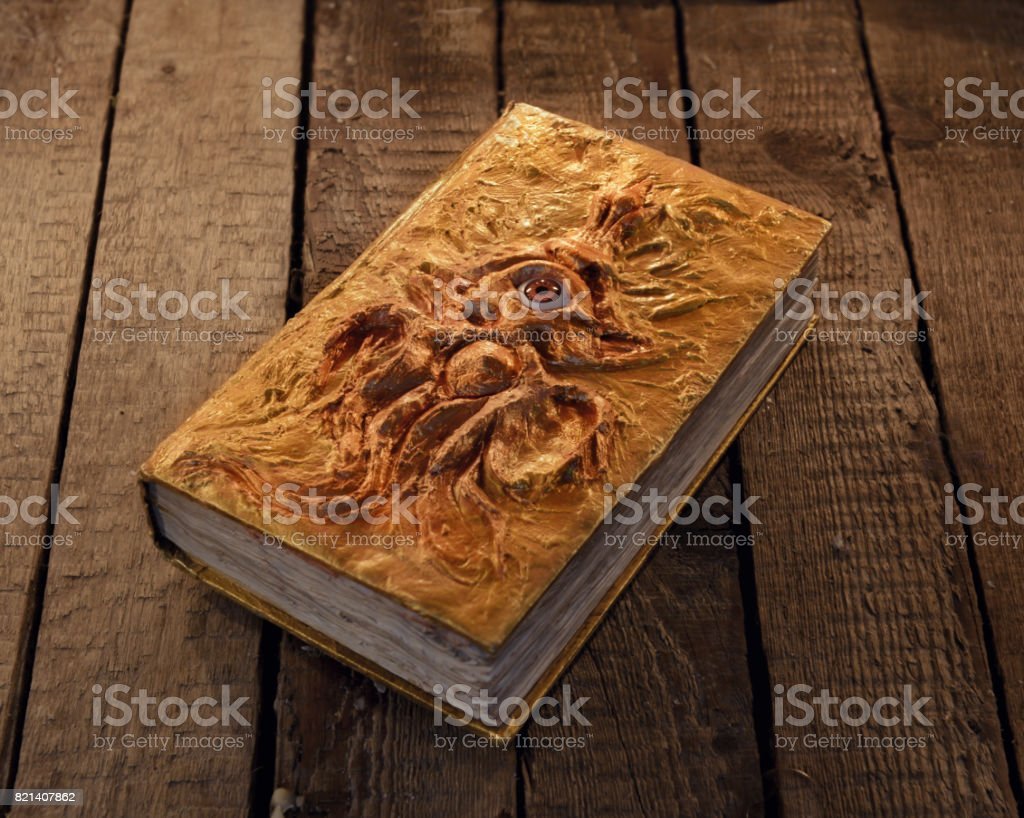 Magic book with golden cover and marine monster stock photo