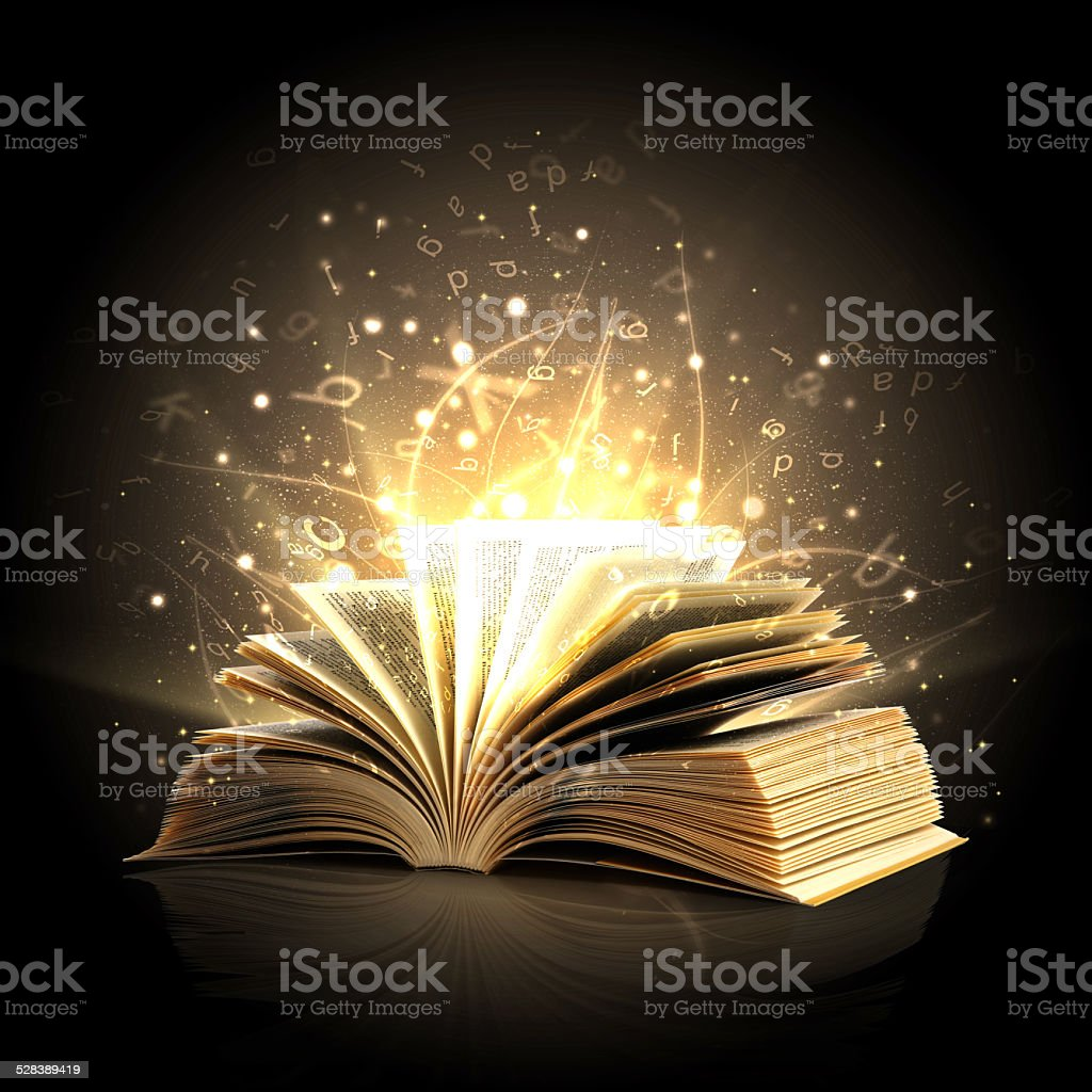 Magic book with magic lights and letters stock photo