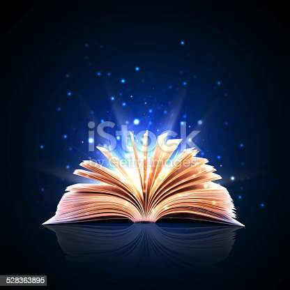 istock Magic book with magic lights 528363895