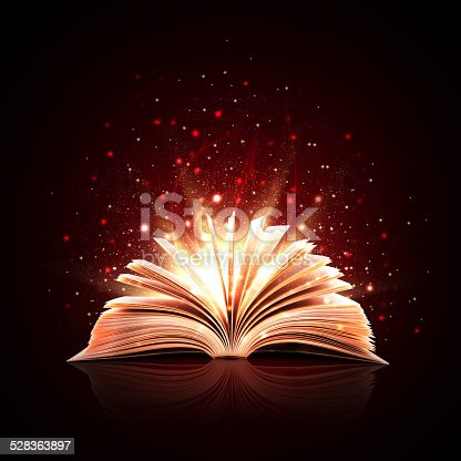 istock Magic book with magic lights 528363897