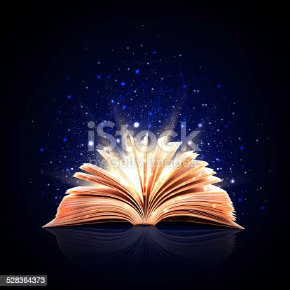 istock Magic book with magic lights 528364373