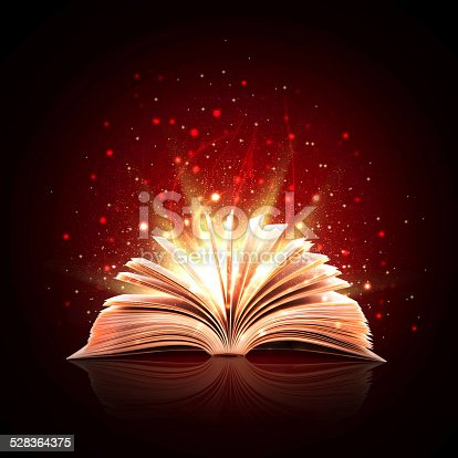 istock Magic book with magic lights 528364375