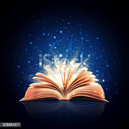 528363897istockphoto Magic book with magic lights 528364377