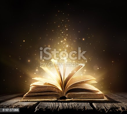 873333822istockphoto Magic Book With Shining Lights 516137066