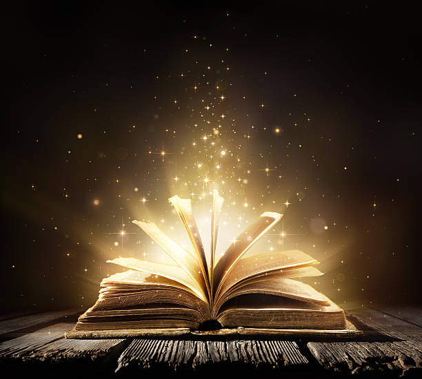 magic book with shining lights - paranormaal stockfoto's en -beelden