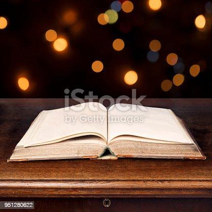528363897 istock photo Magic book with shining lights 951280622