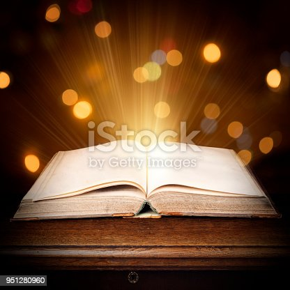 528363897 istock photo Magic book with shining lights 951280960