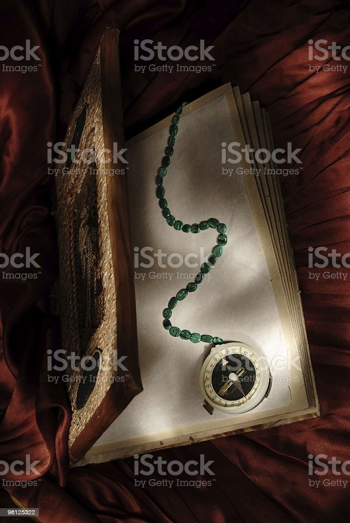 Magic book with wizard compass royalty-free stock photo