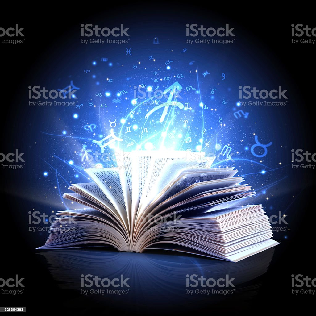 magic book with zodiac symbols stock photo