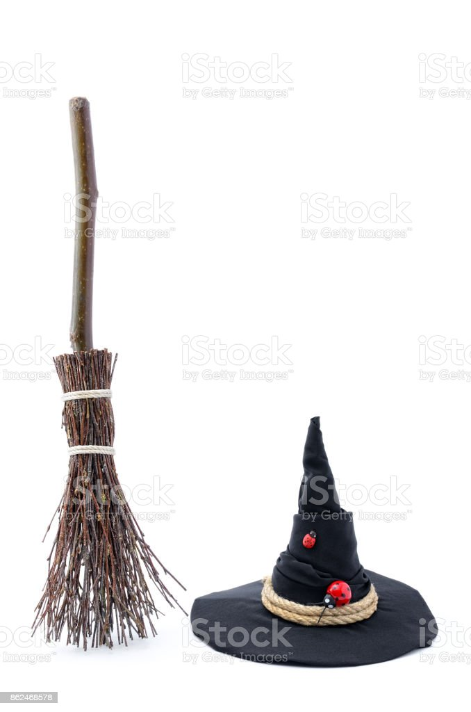 Magic Broom and Witch Hat on a White Background stock photo