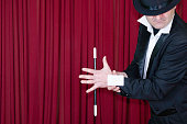 Magician presents blank business card. Conveneint copy space, focus on hands