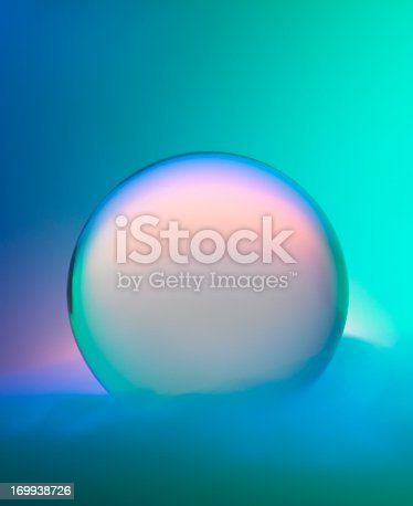 A magical crystal ball surrounded by mist and colors.