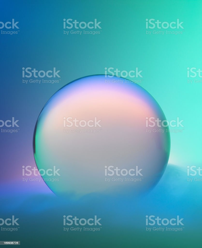 Magic crystal ball with mist and colors stock photo