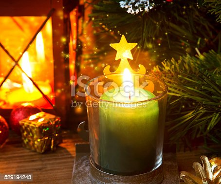 865140324 istock photo Magic Festive Christmas Candle Light 529194243