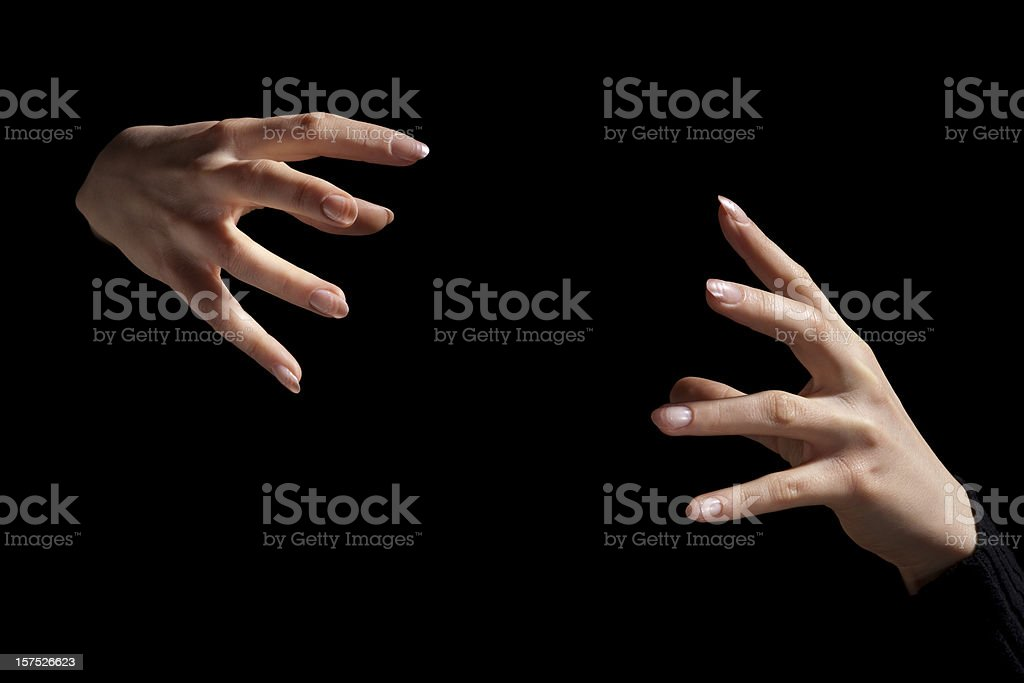 Magic Fingers; Two Intense Hands Hold Nothing Inbetween, Black Background stock photo