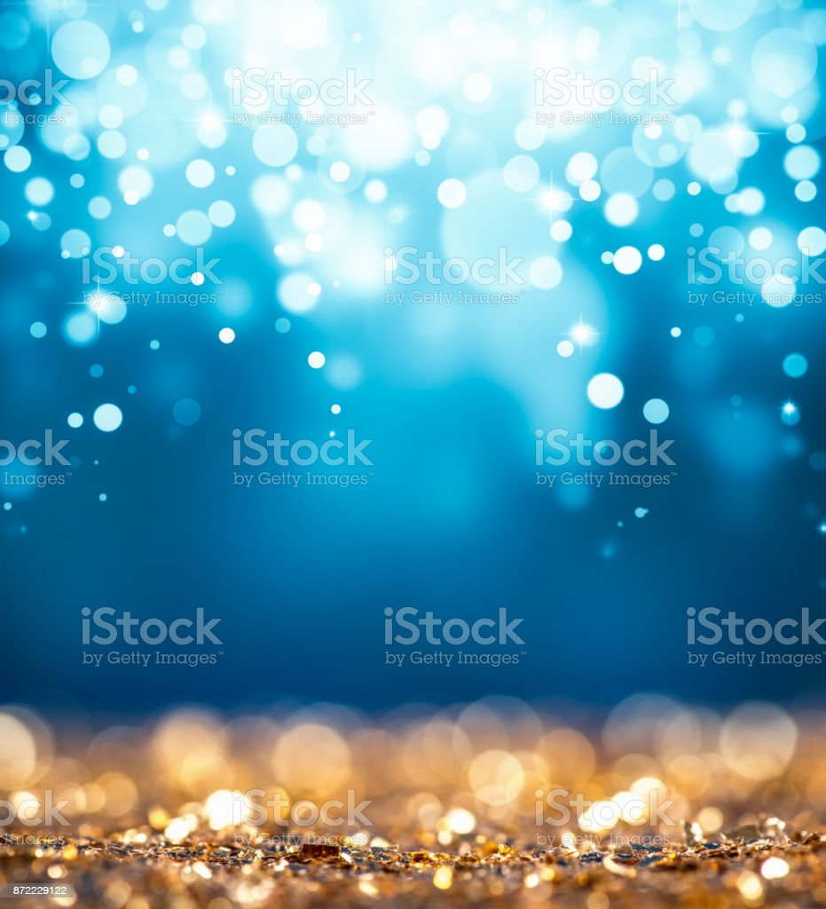 Magic gold and blue glitter stock photo