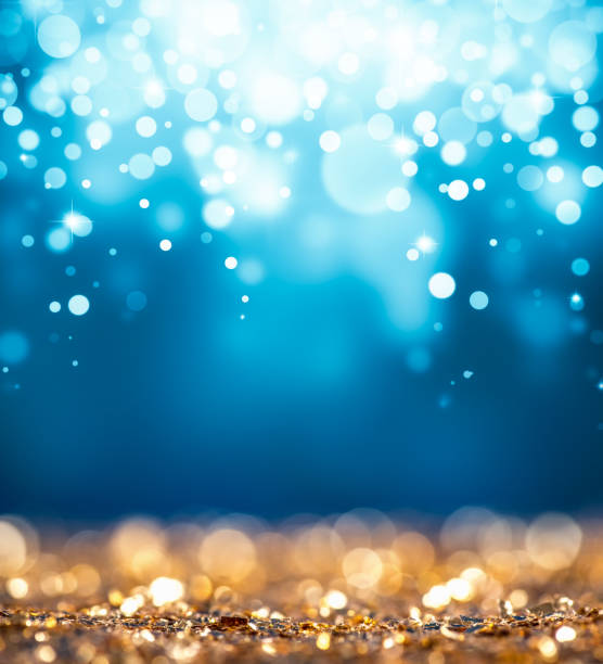 magic gold and blue glitter - ethereal stock pictures, royalty-free photos & images