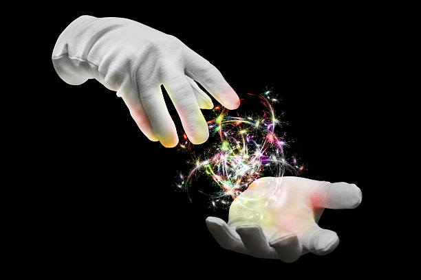 Magic Hands The hands of a magician with colored lights magician stock pictures, royalty-free photos & images