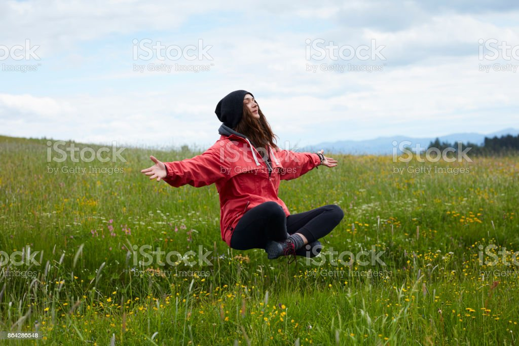 Magic in nature. Woman levitating on the meadow royalty-free stock photo