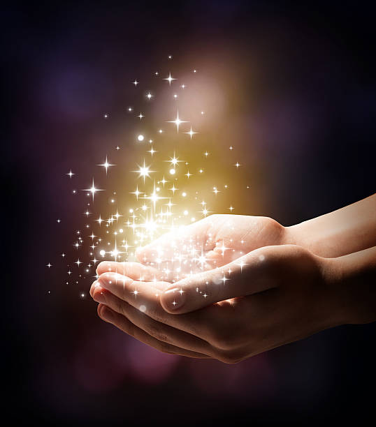 magic in your hands - ethereal stock pictures, royalty-free photos & images