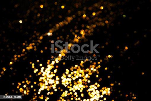 1083023980 istock photo Magic lights christmas bokeh on black background. 1083024038