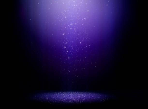 Magic night Stage with one light beam and sparkly dust falling from above stage light stock pictures, royalty-free photos & images